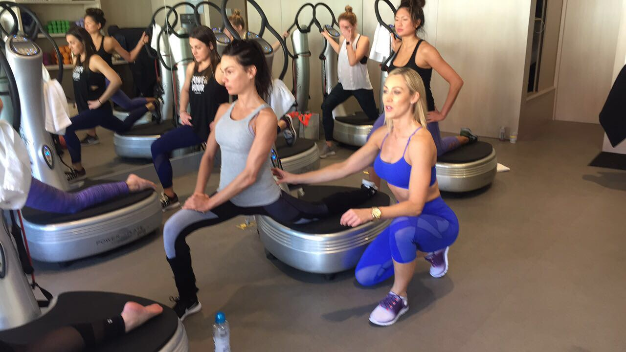 Caroline Pearce mid-instruction on Power Plate class at 'Train like a Gladiator' event